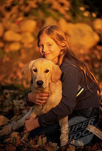 Stock Photo: 1566-034511 Girl and golden retriever