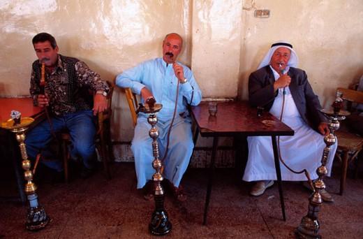 Men smoking water pipes. Deir Er Zor. Syria : Stock Photo
