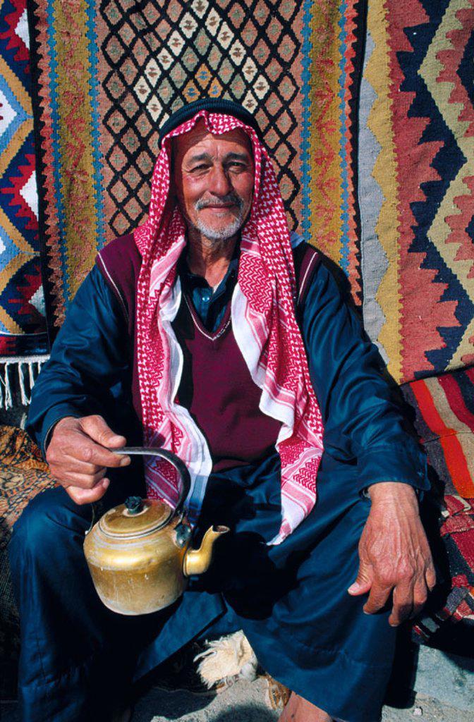 Stock Photo: 1566-037317 Bedouin with teapot. Syria