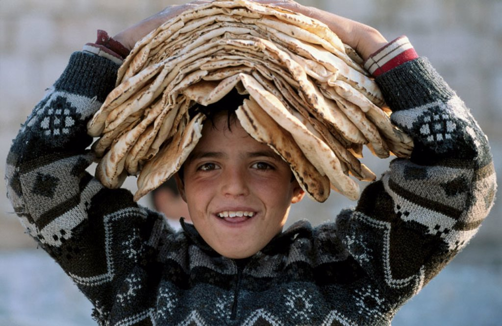 Stock Photo: 1566-037327 Boy wearing breads on his head, Maaloula christian village, Syria