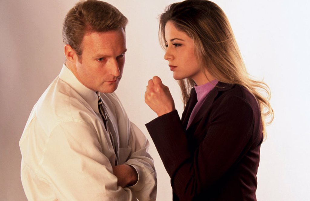 Stock Photo: 1566-03776 Business woman tells man off