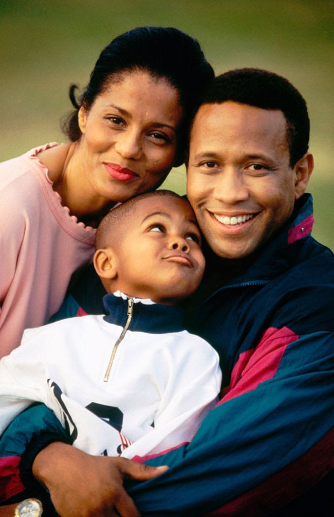 Stock Photo: 1566-041090 African-American Mom, Dad, and son