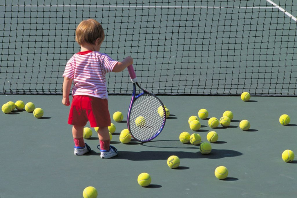 Young child holding tennis racquet : Stock Photo