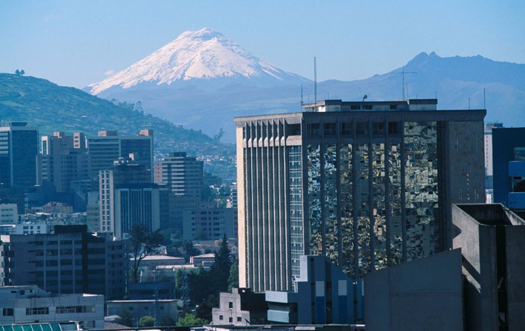 Stock Photo: 1566-045198 Downtown Quito. Volcan Cotopaxi at the background. Ecuador