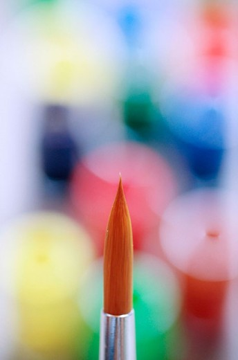 Single Paint brush and out of focus colours. : Stock Photo
