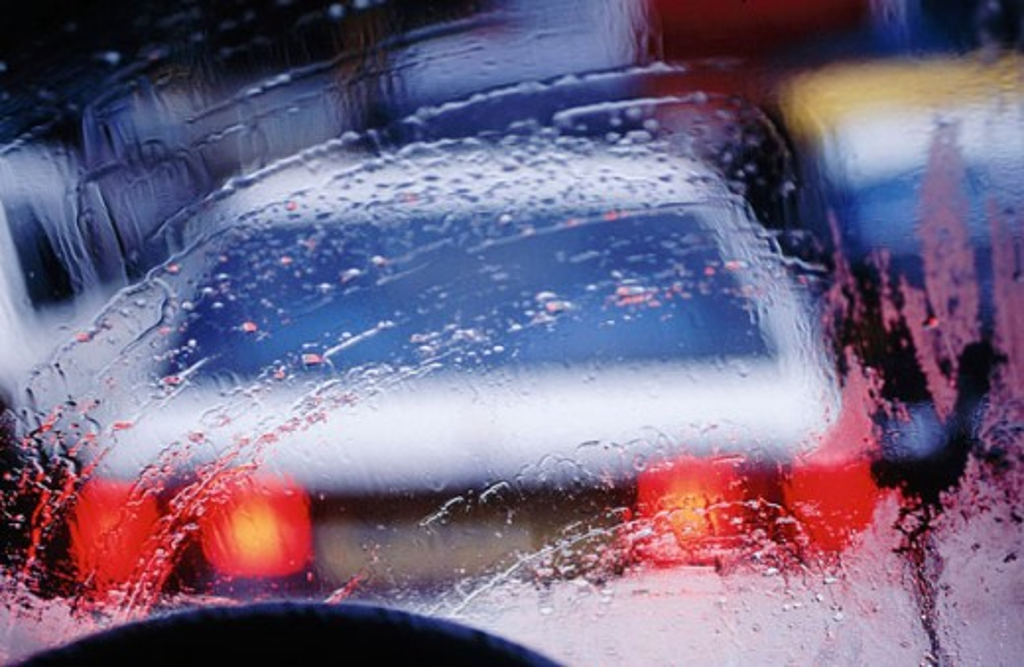 Stock Photo: 1566-048548 Car seen through a monsoon windshield