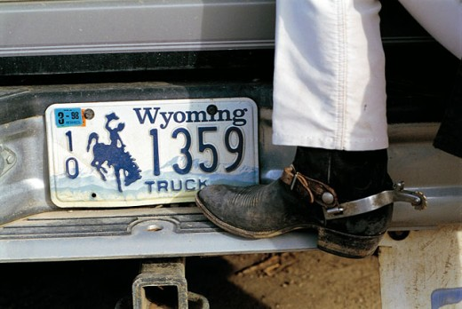Stock Photo: 1566-051885 Car and cowboy boot. Wyoming. USA
