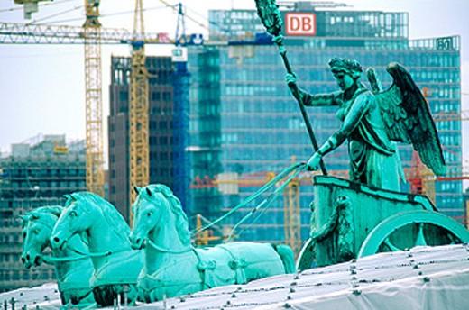 Brandenburg Gate, detail of the Quadriga restoration works with Postdamer Platz buildings in background. Berlin. Germany : Stock Photo