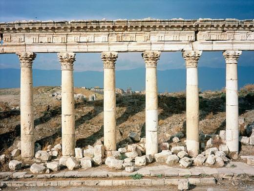 Ruins of colonnade along ´cardo´ (main street in ancient Roman cities). Apamea. Syria : Stock Photo