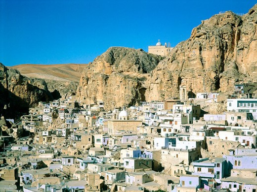 Maalula village with the Catholic monastery of Mar Sarkis (St. Sergius) on top of hill. Syria : Stock Photo