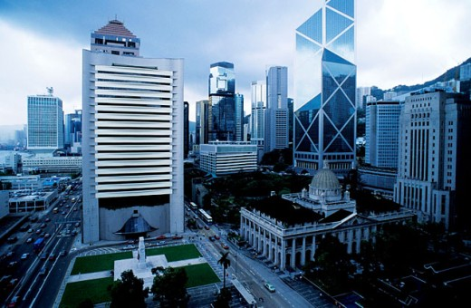 Council Building and Bank of China (by I.M. Pei) building on the right at dusk. Hong Kong. China : Stock Photo