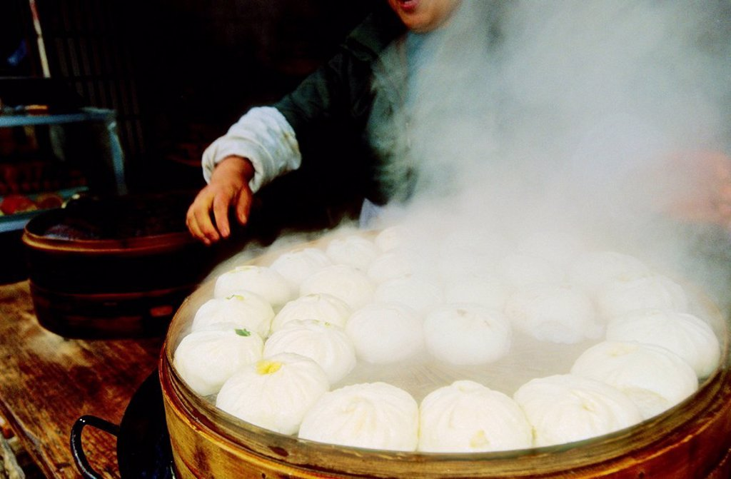 Stock Photo: 1566-054951 Cooking Dim Sum in a popular market by a canal. Suzhou. Kiangsu province, China