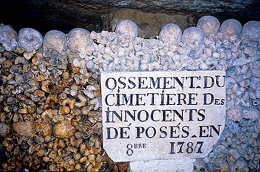 Bones and skulls from old cemeteries piled up in catacombs. Paris. France : Stock Photo