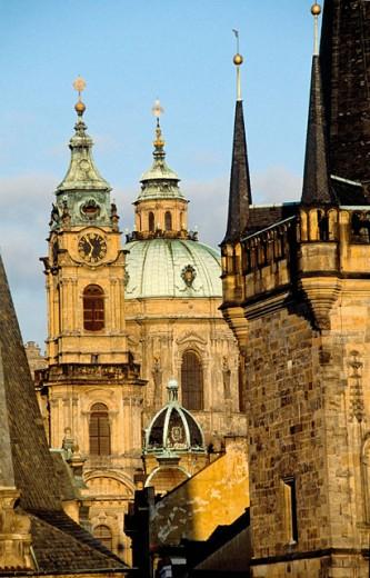 Stock Photo: 1566-055270 Saint Nicholas baroque church. Charles Bridge Tower at fore. Mala Strana quarter. Prague. Czech Republic.