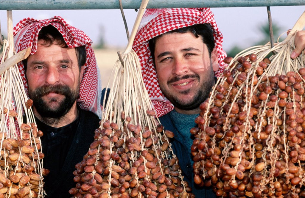 Stock Photo: 1566-055663 Brothers selling dates. Palmyra. Syria