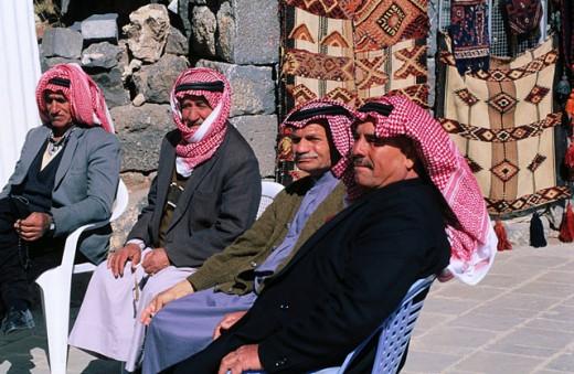 Men sitting at a café terrace, Bosra, Syria : Stock Photo