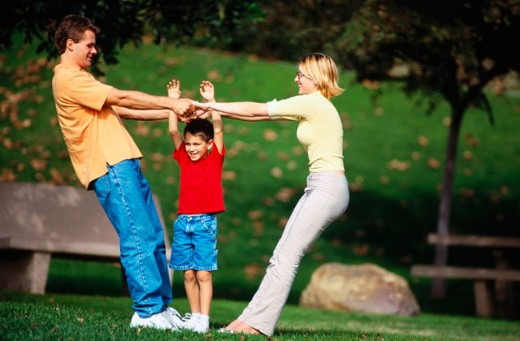 Family outdoors having fun : Stock Photo