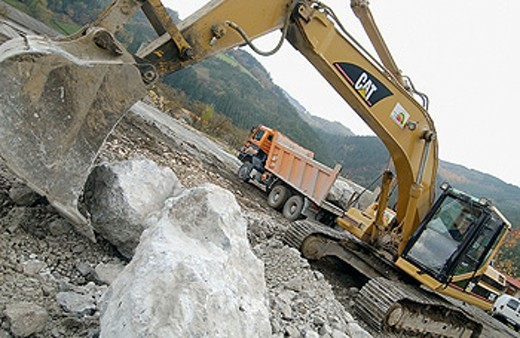 Loading rocks at quarry for construction of breakwater : Stock Photo