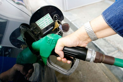 Filling car with gasoline : Stock Photo