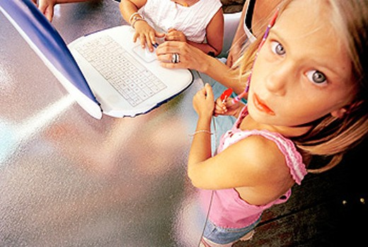 Stock Photo: 1566-066853 Children learning with a laptop