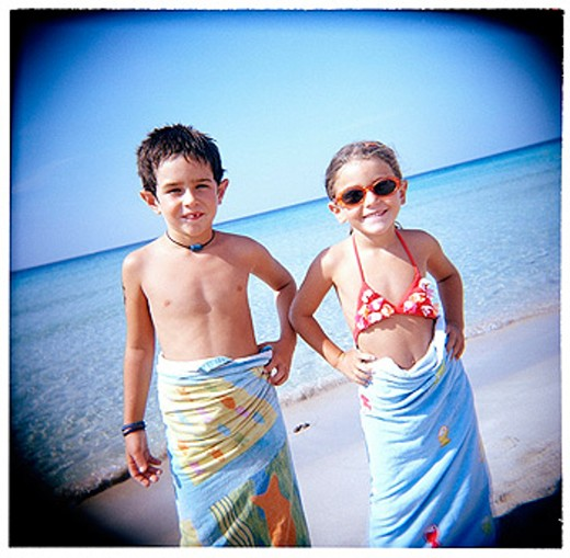 Boy and girl on the beach : Stock Photo