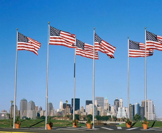 Stock Photo: 1566-068710 USA flags and Manhattan skyline. New York City. USA