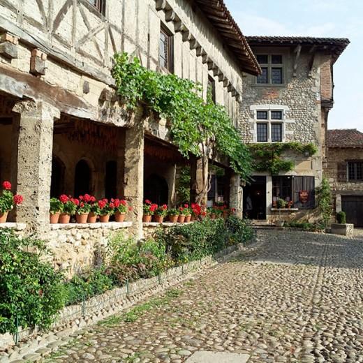 Place de la Halle square and arcades. Medieval city of Pérouges. Rhône Valley. France. : Stock Photo