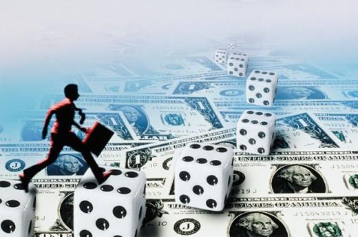 Businessman takes a gamble : Stock Photo