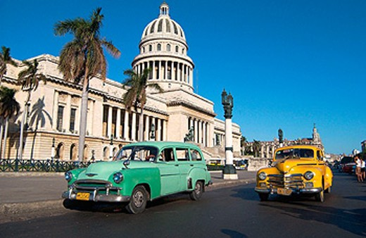 Capitol Building and old cars. Havana. Cuba : Stock Photo