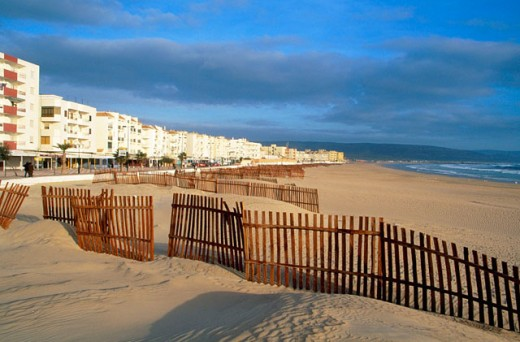 Stock Photo: 1566-075808 Wooden barriers supposed to hinder the sand from invading the promenade. Barbate. Cádiz province. Andalusia. Spain