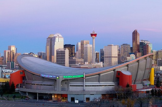 Stock Photo: 1566-091351 City skyline with Saddledome from Ramsay area at dawn. Calgary. Alberta, Canada
