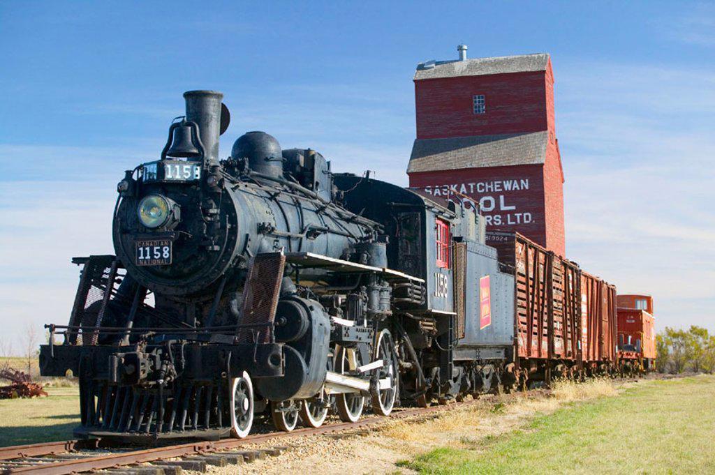 Stock Photo: 1566-091606 Western Development Museum and Village, steam train and grain elevator. North Battlerford. Saskatchewan, Canada