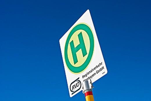 Stock Photo: 1566-095434 Sign RVO Regionalverkehr Oberbayern GmbH at bus stop. Bavaria. Germany