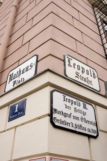 Signs at the city hall at the corner Rathausplatz and Leopoldsteet in Klosterneuburg near Vienna. Austria : Stock Photo
