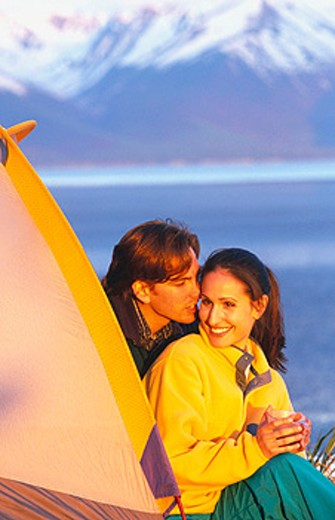 Couple at camp above Turnagain Arm. Chugach State Park. Alaska : Stock Photo
