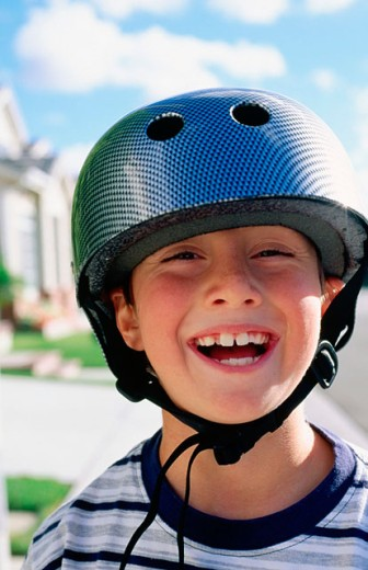 Boy with helmet : Stock Photo