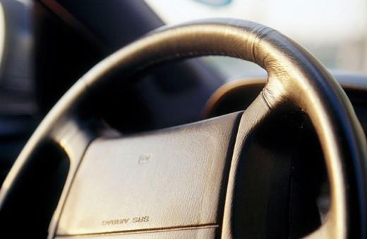 Steering wheel with the acronym for ´Supplemental Restraint inflatable air-bag System´ (SRS airbag) : Stock Photo