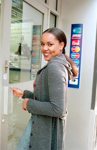 Girl entering a bank : Stock Photo