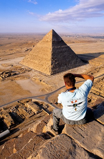 Climbing on the pyramids which is strictly forbidden and dangerous Gizeh Cairo suburbs Egypt : Stock Photo