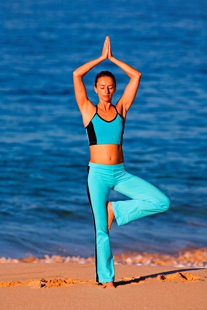 Stock Photo: 1566-1002032 Woman performs yoga at Makena, Maui, Hawaii