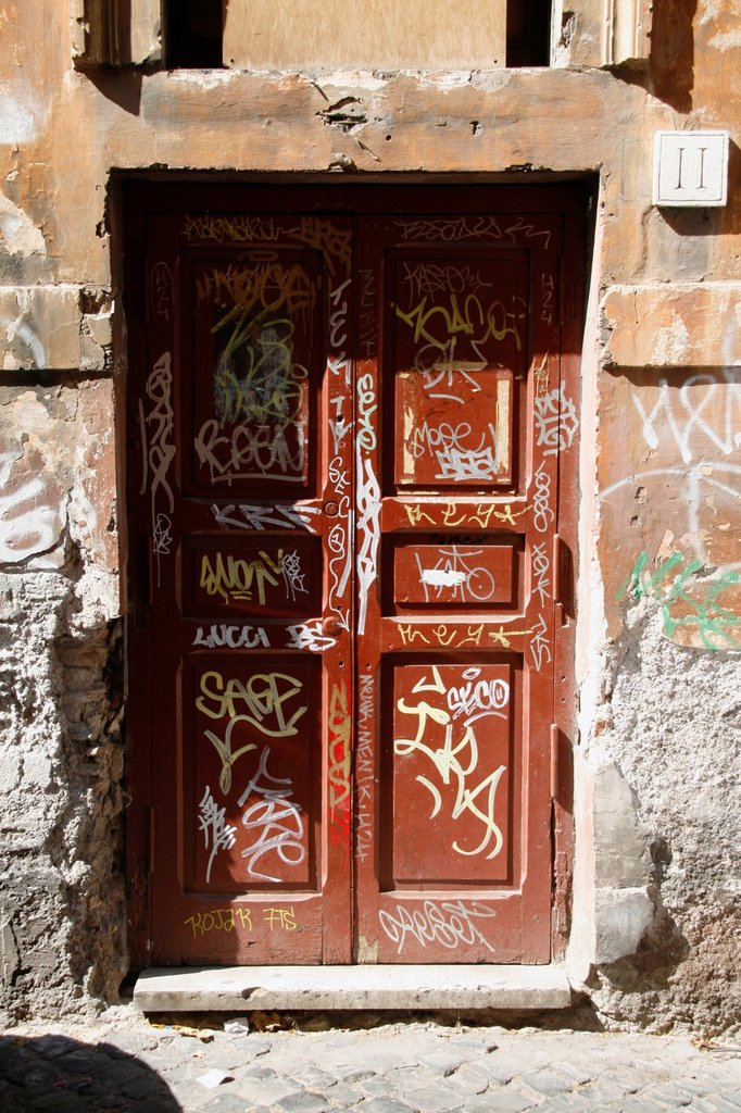 Stock Photo: 1566-1002163 lots of covered graffiti on wooden door
