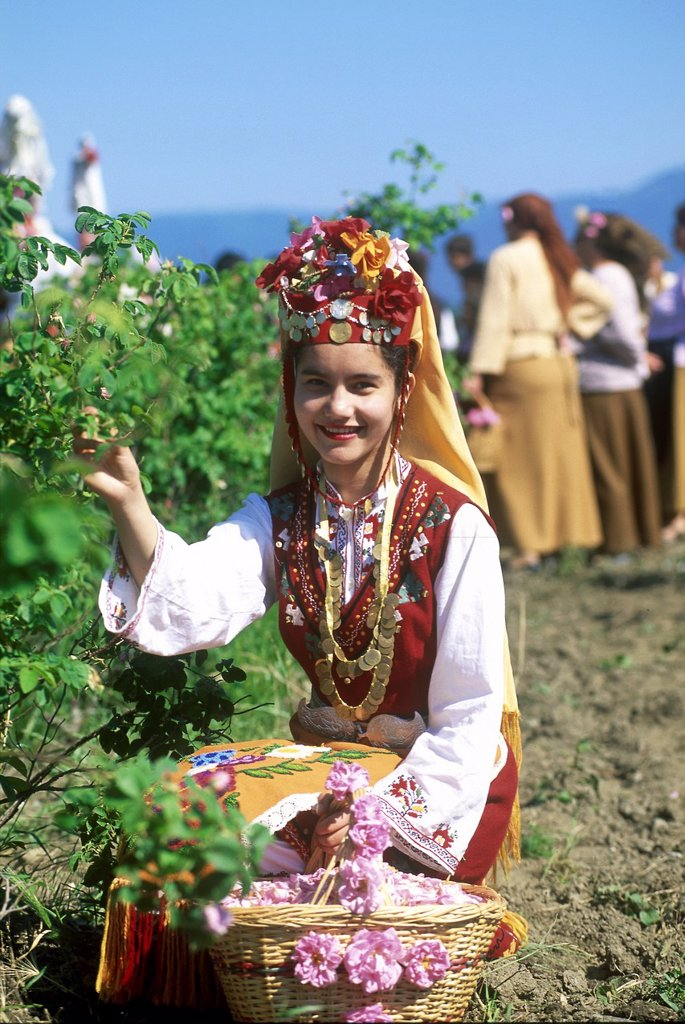 Stock Photo: 1566-1003273 traditional dressed young girl in a rose garden during the Rose Festival in the Rose Valley, Kazanlak, Bulgaria, Europe