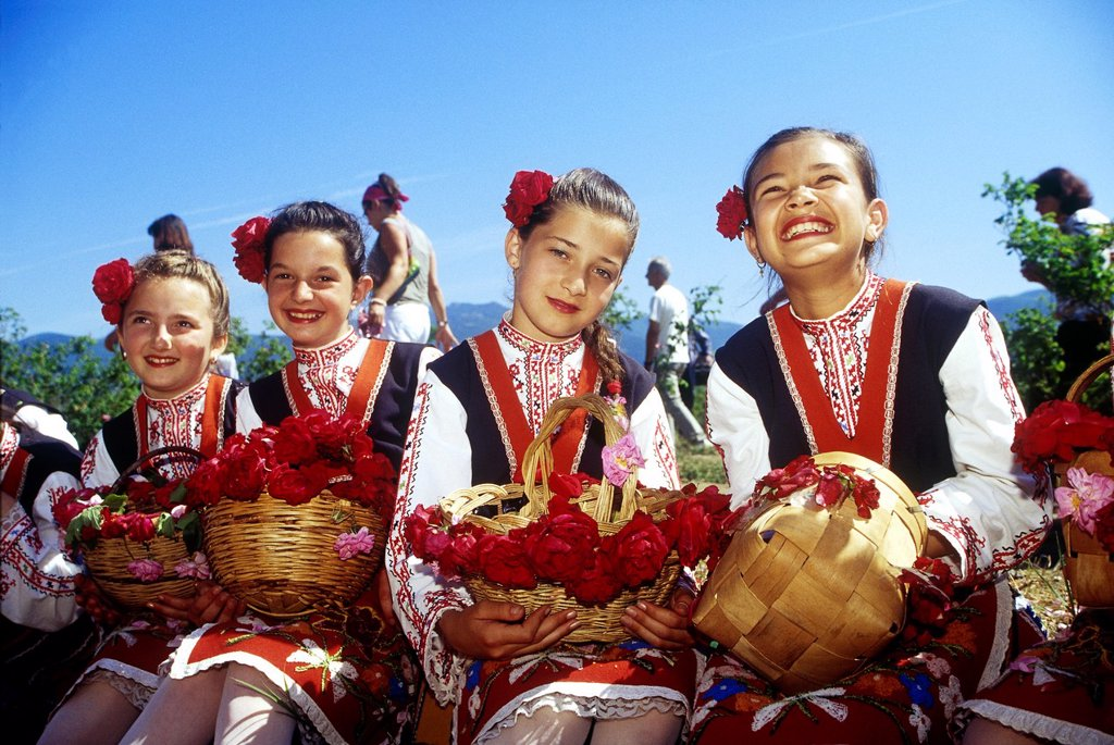 Stock Photo: 1566-1003359 traditional dressed young girls in a rose garden during the Rose Festival in the Rose Valley, Kazanlak, Bulgaria, Europe