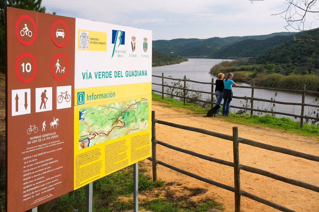 Stock Photo: 1566-1003531 Vía verde del Guadiana-sign and tourists  El Granado  Huelva-province  Spain