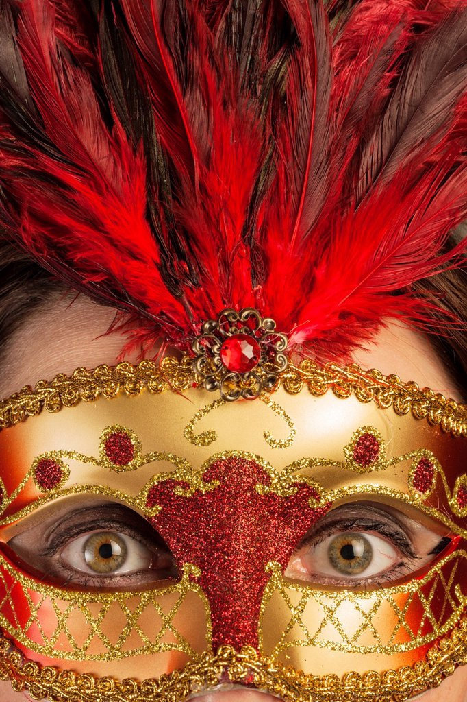 Wide opened eyes of a woman behind a venetian mask : Stock Photo