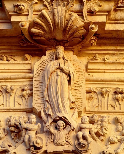 Detail of facade of Mission San Jose y San Miquel de Aguayo, showing Our Lady of Guadalupe Construction began 1720 San Antonio Missions National Historical Park, Texas : Stock Photo
