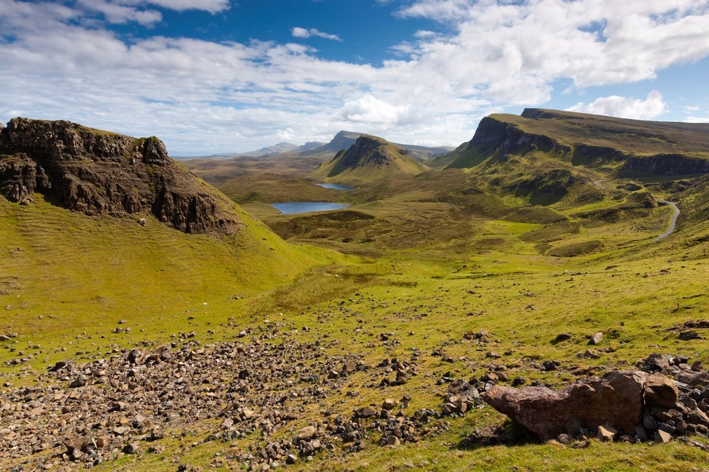 View from The Quiraing, a landslip on the eastern face of Meall na Suiramach over Loch Leum na Luirginn and Loch Cleat, the northernmost summit of the Trotternish Ridge on the Isle of Skye, Scotland, United Kingdom, Europe : Stock Photo