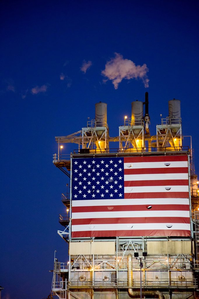 Wilmington, California - An oil refinery, operated by BP, displays a huge American flag : Stock Photo