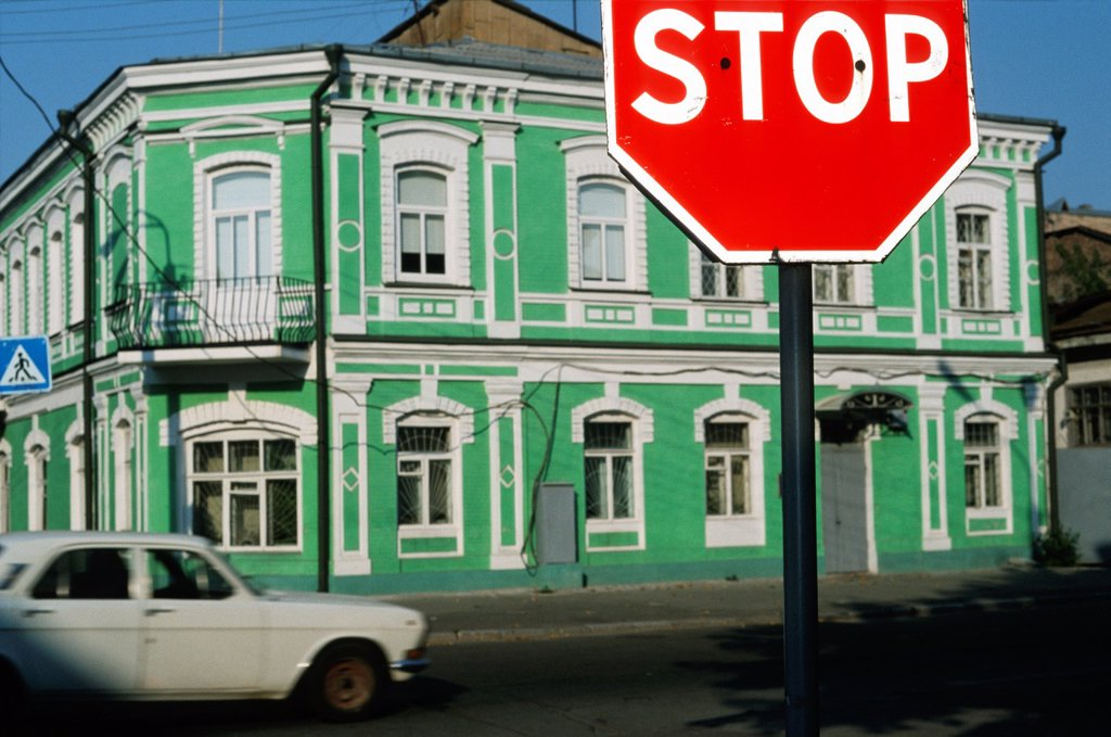 Stock Photo: 1566-1007161 Stop sign and green painted house, Podil district, Kiev, Ukraine