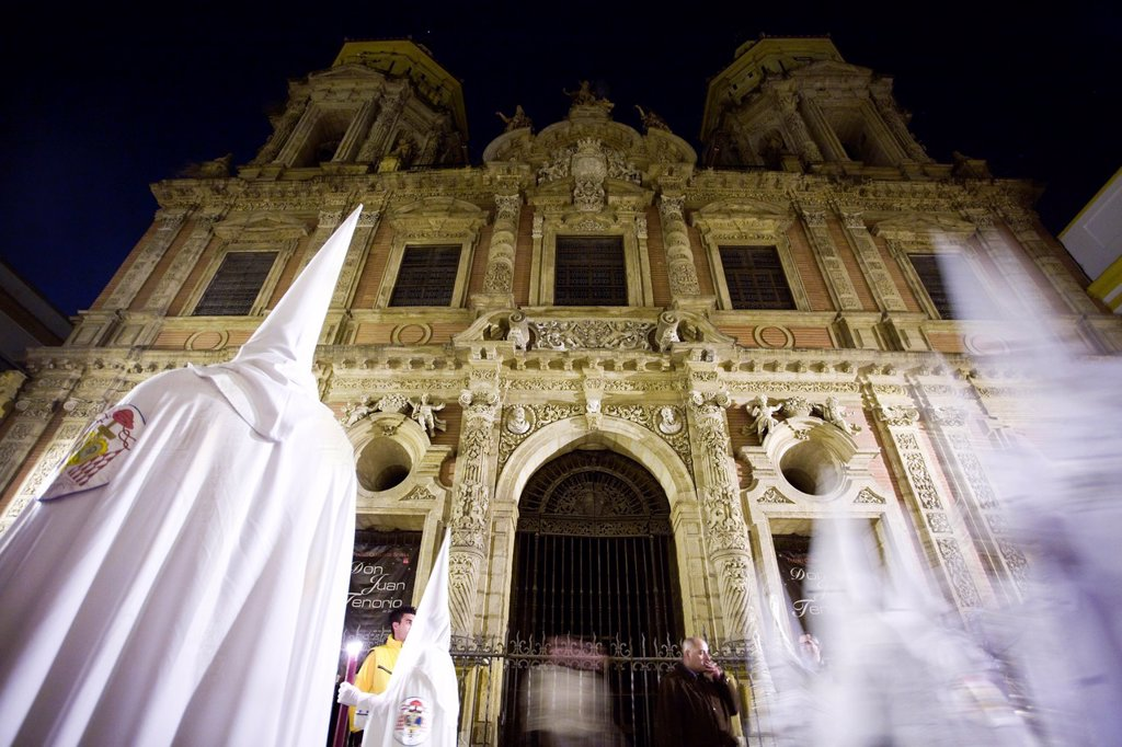 Hooded penitents in front of San Luis church, Holy Week, Seville, Spain : Stock Photo